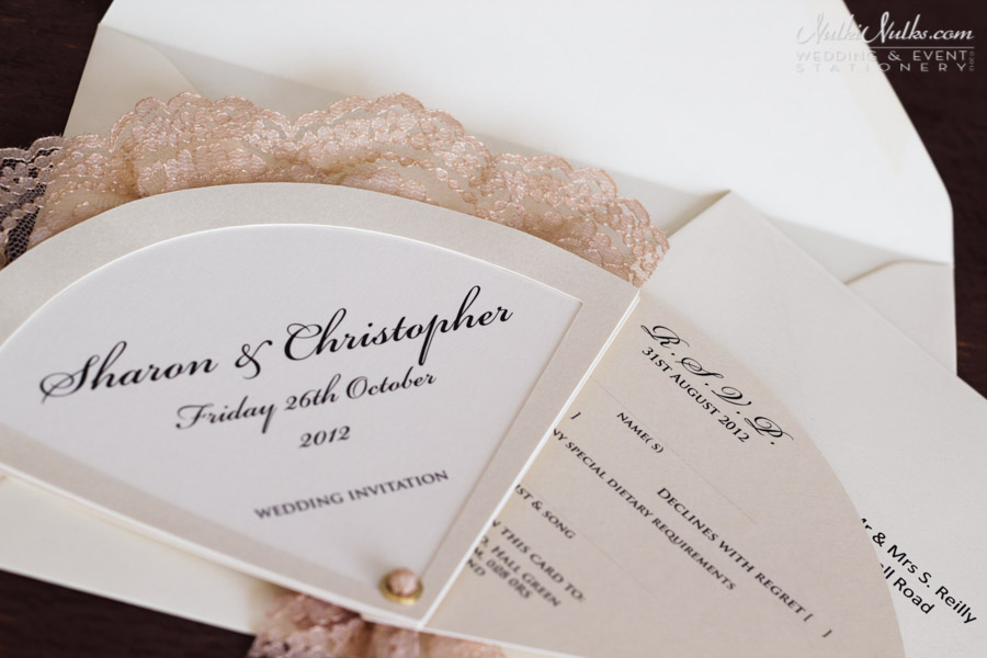 fan shaped wedding invitation with lace detail and rsvp