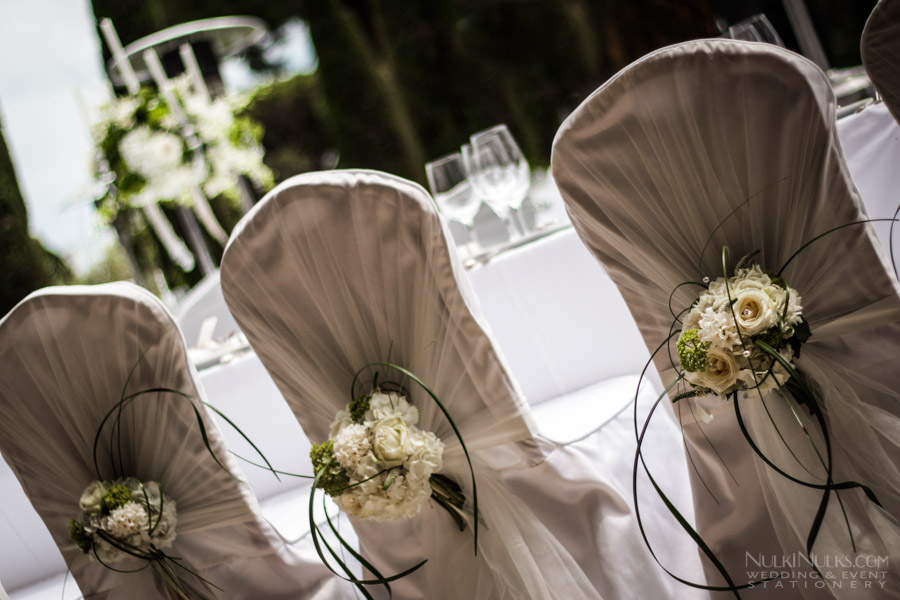 Chairs dressed with flowers for a wedding