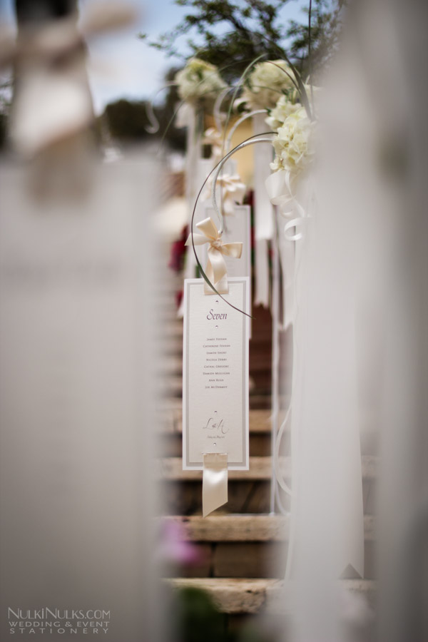 Hanging table plan with ribbon detail