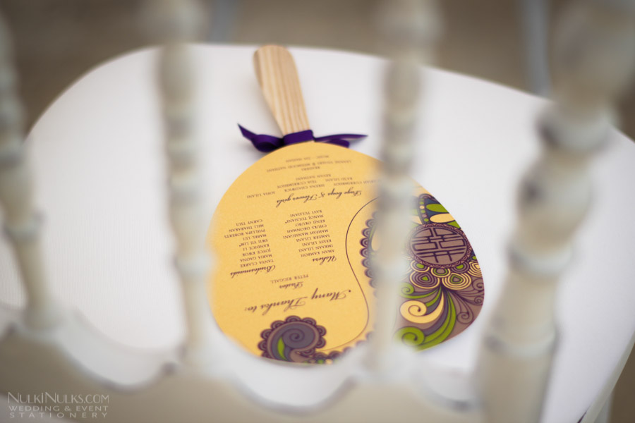 Wedding paddle fan on ceremony chair