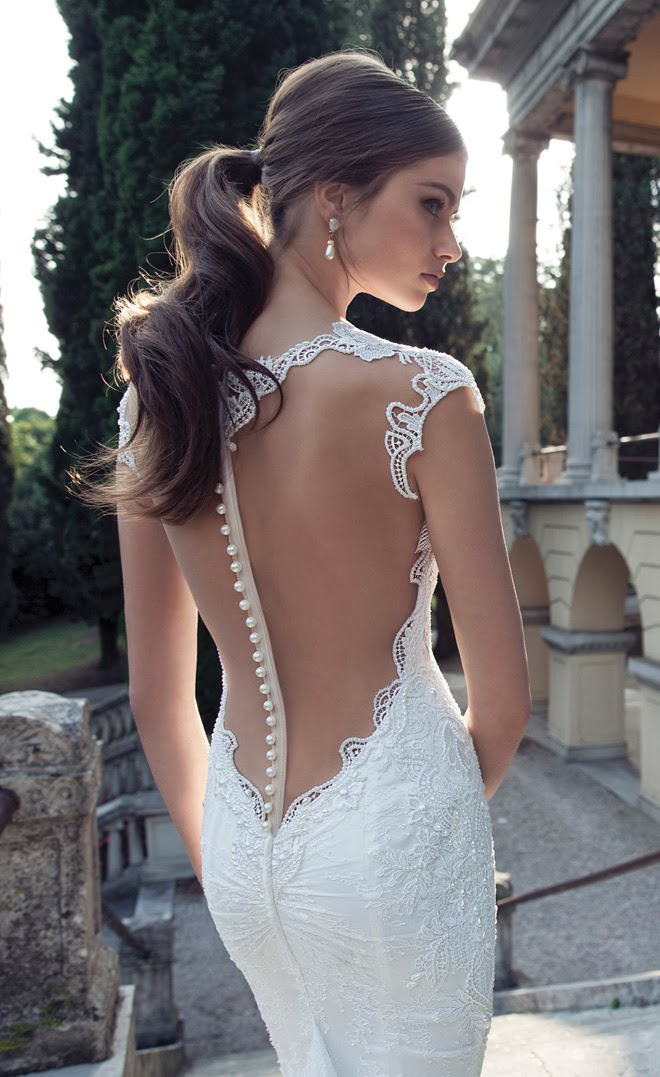 Model wearing low cut back detailed wedding dress