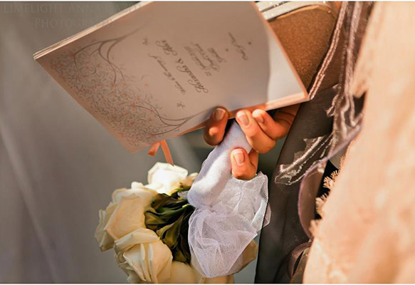 Bride holding a Wedding Program