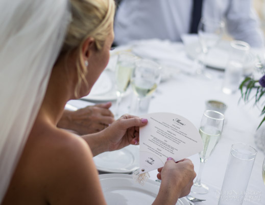 Bride holds Fan-shaped Wedding Menu