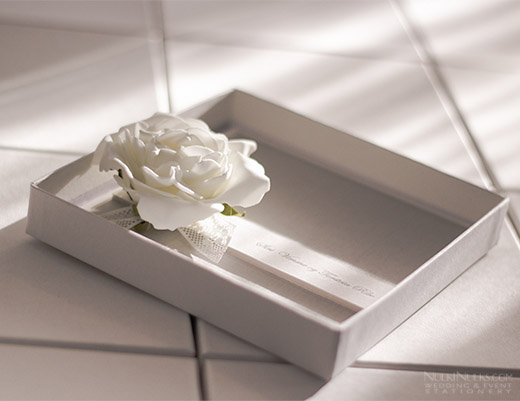 Wedding Invitation with flower presented in a box